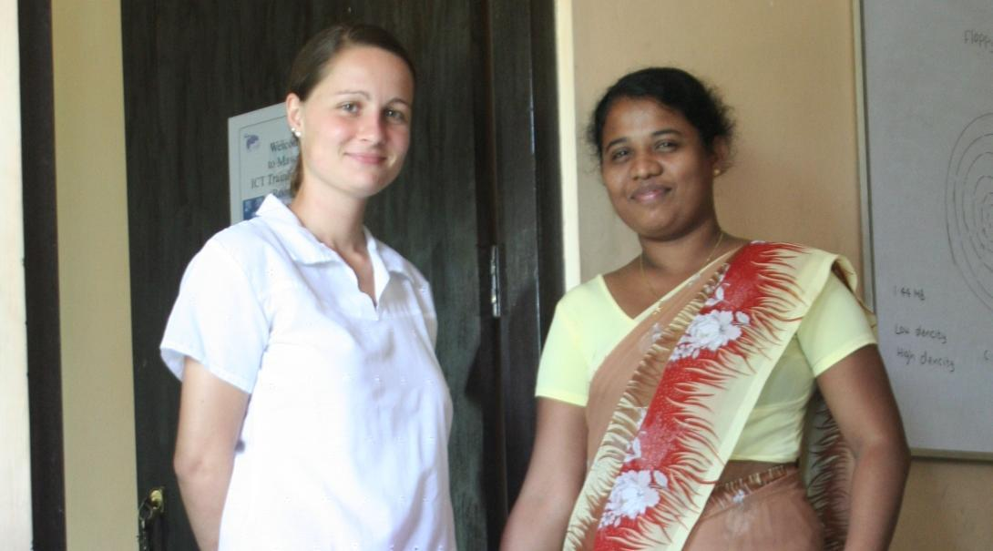 A Projects Abroad student on the business internship in Sri Lanka takes a photo with her supervisor.